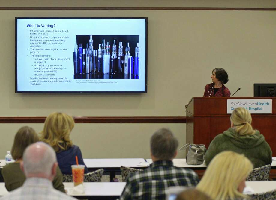 "Pulmonologist Alissa Greenberg, MD, presents ""Vaping & Juuling: What are the Consequences?"" at Greenwich Hospital in Greenwich, Conn. Tuesday, March 5, 2019. Pulmonologist Alissa Greenberg, MD, and Psychiatrist Jeremy Barowsky, MD, delivered a presentation on vaping and Juuling, particularly in adolescents, as well as the short-term and long-term developmental effects of nicotine dependence. Though it is generally agreed that vaping is not as dangerous as smoking cigarettes, the long-term effects are largely unknown and the trend of middle school- and high school-aged children vaping has many doctors worried. Photo: Tyler Sizemore / Hearst Connecticut Media / Greenwich Time"