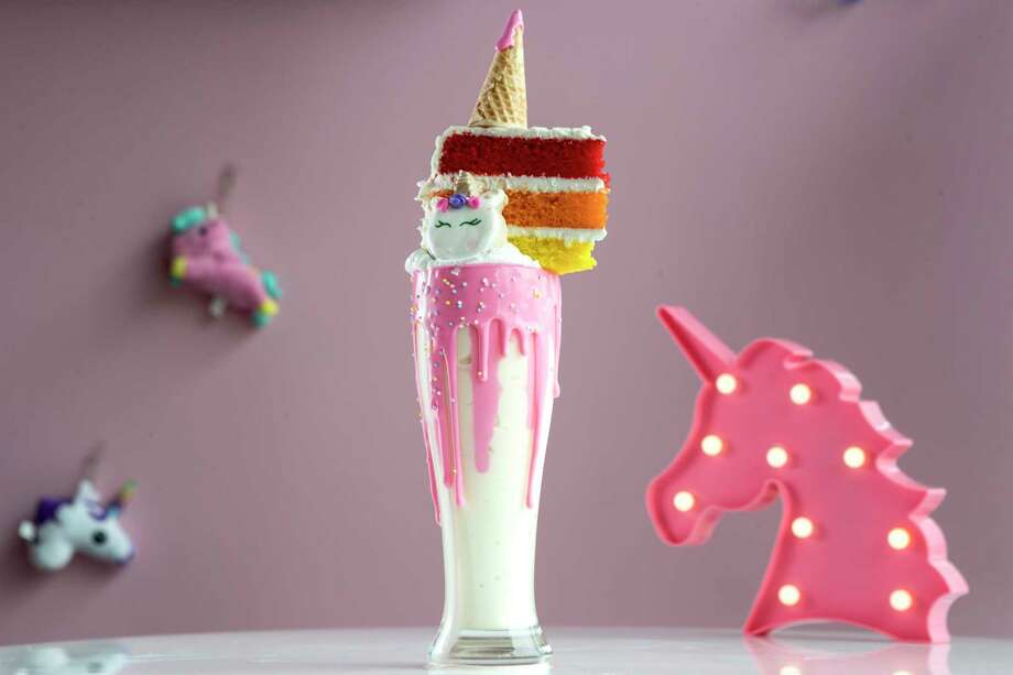 A Unicorn milkshake, topped with rainbow cake, is on the menu at Unicorn Magical Dessert Bar opening March 9 in Montrose. Photo: Brett Coomer, Staff Photographer / © 2019 Houston Chronicle