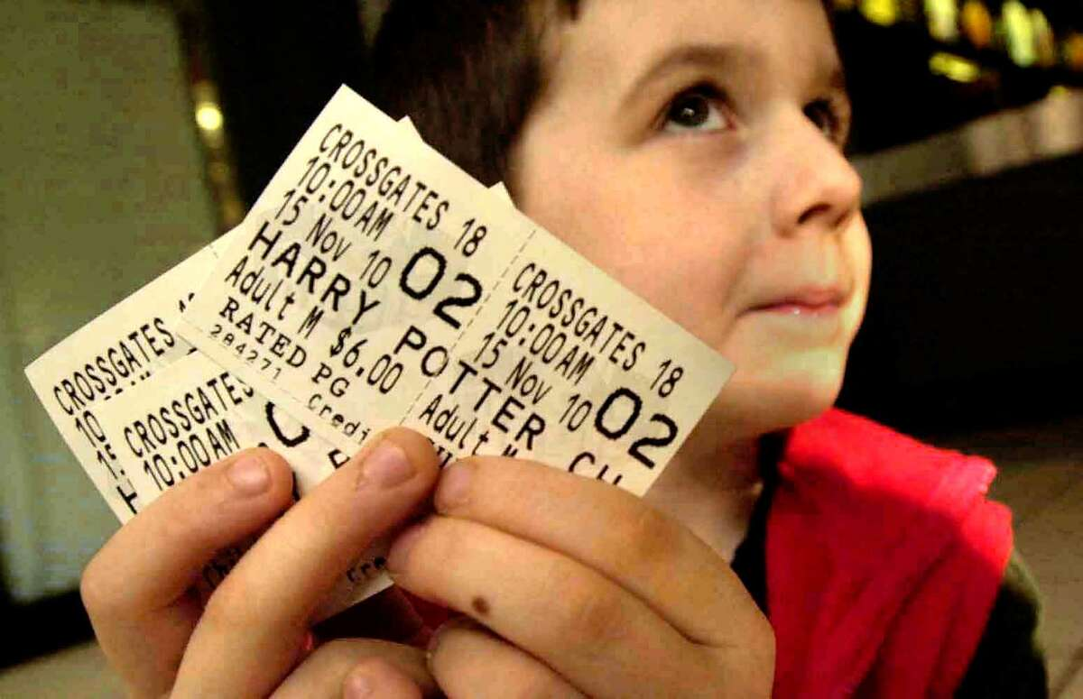 Tyler Peek,6, of Clifton Park proudly shows off his Harry Pottter movie tickets before he goes to see the first showing of the new movie at the Crossgates Mall theater, November 15,2002 (Times Union photo by STEVE JACOBS)