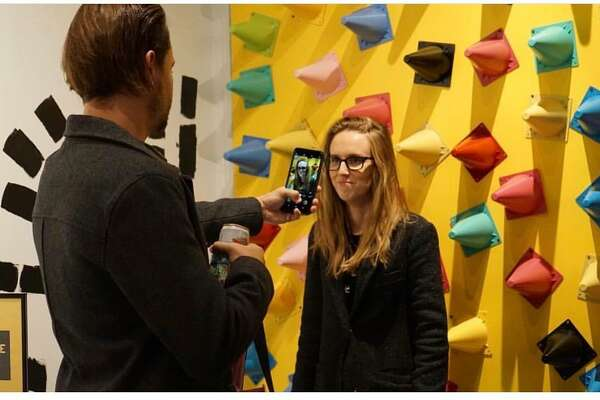 """Visitors interact with """"The Whimsy World"""" in downtown Houston at an art activation by local artist Shelbi Nicole. The exhibit will open in Sugar Land Town Square on March 15."""