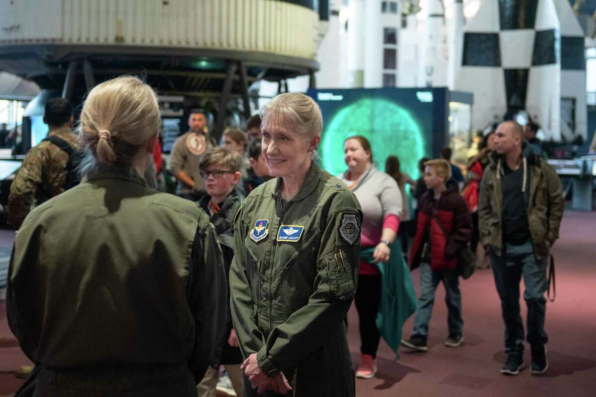 Brig. Gen. Jeannie Leavitt at the Captain Marvel movie screening at Smithsonian Air & Space Museum in Washington, D.C. Leavitt (right) speaks with another Air Force officer before the movie.