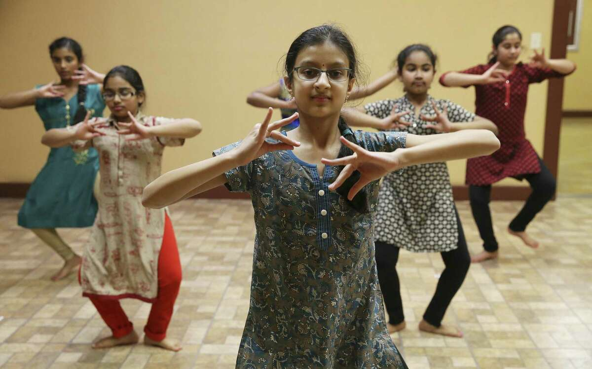 Nithya Chennupati and other students rehearse. Dance serves as both a pure physical and creative release and also a way to tell the myths, legends and other tales, including religious stories going back thousands of years or more.