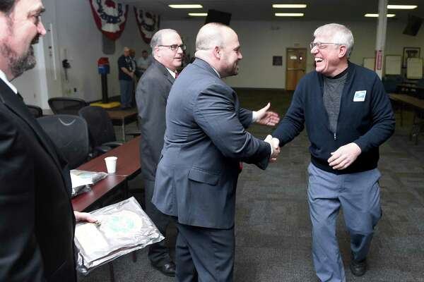 New Haven Postmaster Thomas Sullivan (center) congratulates letter carrier Vincent Corniello (right) who was among 40 recipients of the National Safety Council's Million Mile Award at the Brewery Street Post Office in New Haven on March 8, 2019. Recipients of the award have driven for over 30 years without any non preventable at-fault accidents. Carriers out of the Brewery Street Post Office drive over 58,000 miles per month. From left are John O'Mara, manager of customer service, David Mastroianni, Connecticut Valley District Manager, Sullivan and Corniello.
