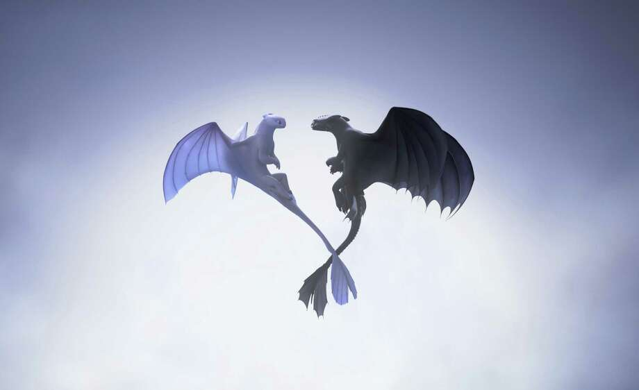 "This image released by Universal Pictures shows characters, female Light Fury dragon, left, and Night Fury dragon Toothless, in a scene from DreamWorks Animation's ""How to Train Your Dragon: The Hidden World."" Photo: DreamWorks Animation Via Associated Press / © 2019 DreamWorks Animation LLC. All Rights Reserved."