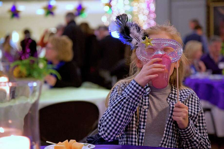 Jacqueline Elsener, 10, of Westport, in her mask at the Mardi Gras Music & Mission party. Photo: Jarret Liotta / For Hearst Connecticut Media / Westport News Freelance