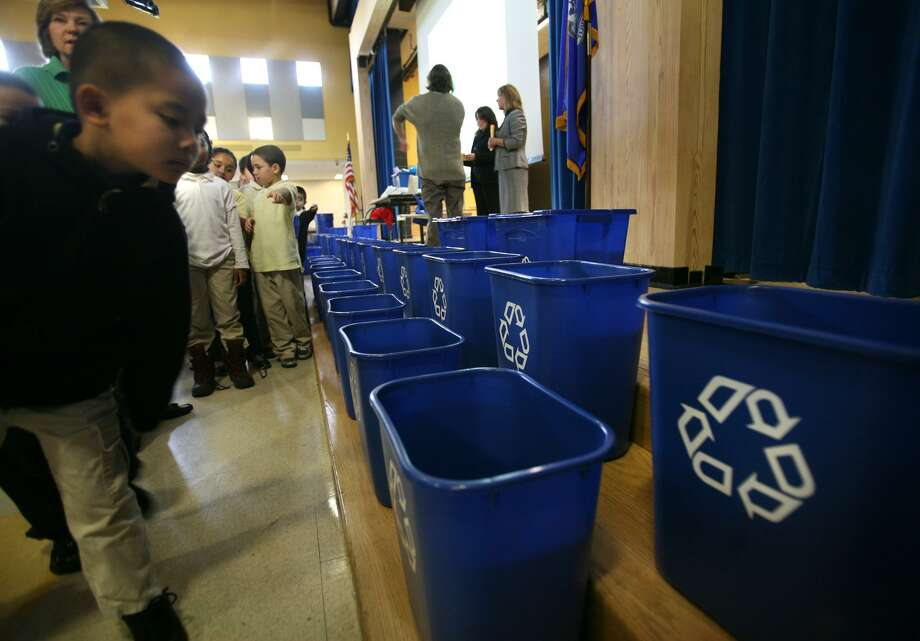 In a 2011 file photo, students checked out the bright blue recycling bins distributed to Bridgeport classrooms. Photo: Brian A. Pounds / ST / Connecticut Post