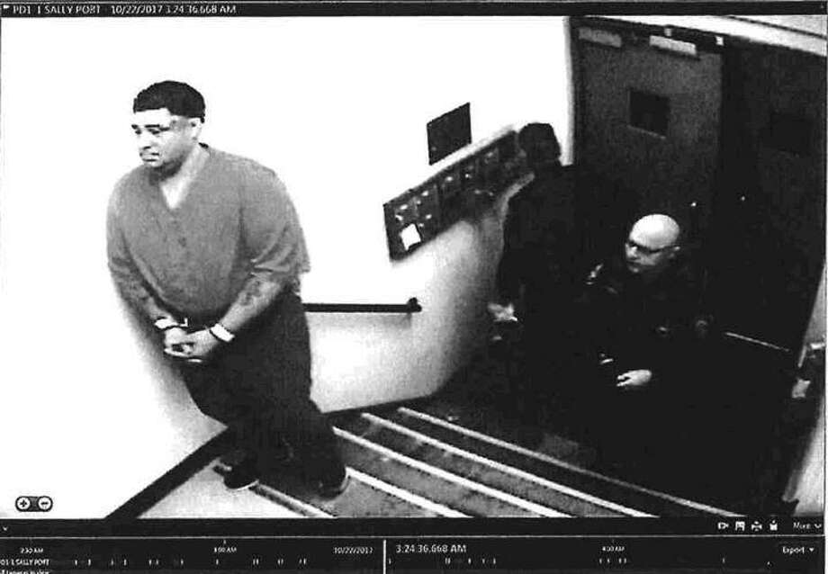 """This photo released in the Bridgeport Police Department's Internal Affairs investigation shows """"Civilian Dentention [sic] Jose Figeroa poking Mr. [Peter] Diaz on the chest in front of male cell 7,"""" on Oct 21, 2017. Photo: Bridgeport Police Department"""