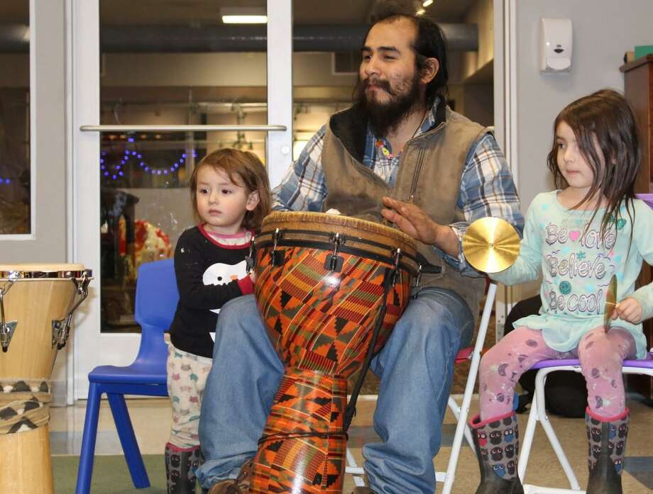 KidsPlay Children's Museum held its second Family Friday event of 2019 with the theme, Move and Groove. Families spent the evening discovering and celebrating music and movement from cultures around the world. Children and caregivers had the opportunity to make an international meal, create an African Spin Drum, join singer/songwriter Susan Strand in a drum circle, above, and finally wind down with a slumber story time. KidsPlay is open to the public Wednesday from 10 a.m. to 6 p.m. and Thursday to Sunday from 10 a.m. to 4 p.m. For more information, visit www.kidsplaymuseum.org. Photo: Contributed Photo