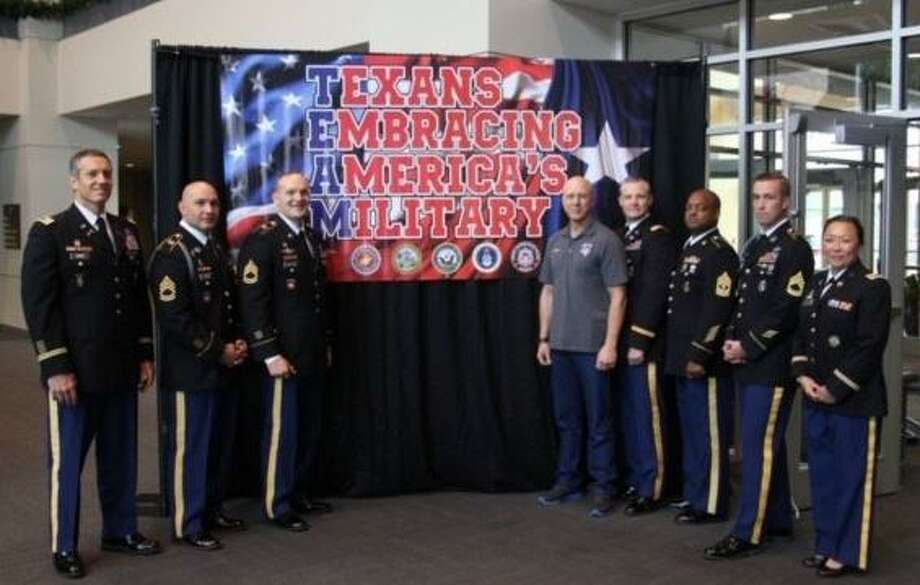 Ralph Oliver, fourth from left, poses with Lt. Col. Damon Robins and the Houston U.S. Army Recruiting Battalion at a send-off for Texans Embracing America's Military. Photo: Courtesy Ralph Oliver / Courtesy Ralph Oliver