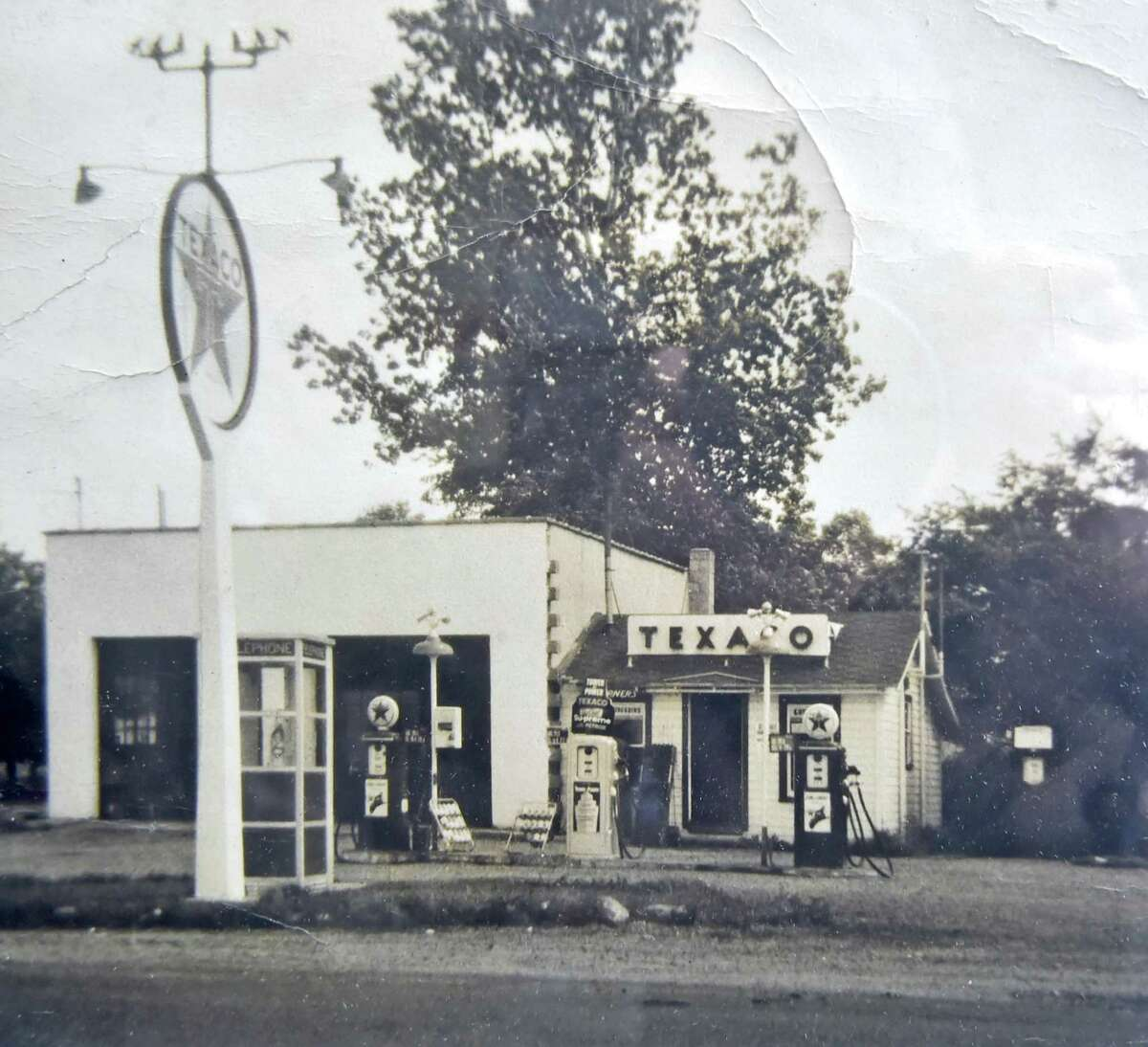 A vintage photograph shows The Four Corners Gas Station on Route 80 in Guilford. The gas station has been family run since 1933.