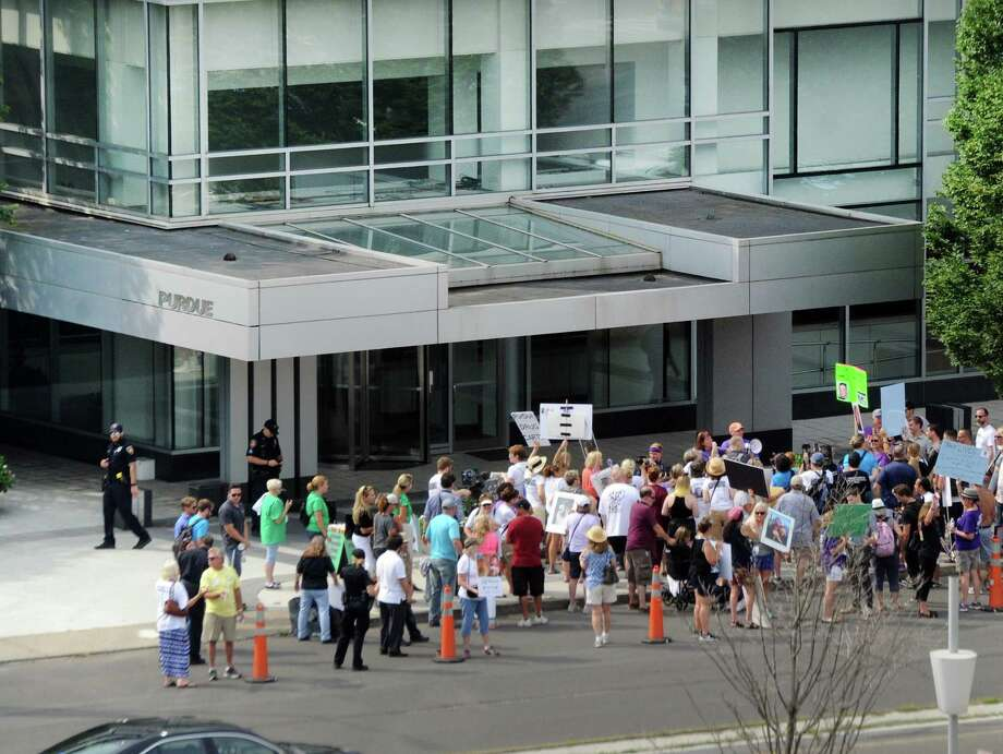 Protesters demonstrate outside Purdue Pharma's headquarters at 201 Tresser Blvd in downtown Stamford in August. Photo: Hearst Connecticut Media File Photo / Greenwich Time
