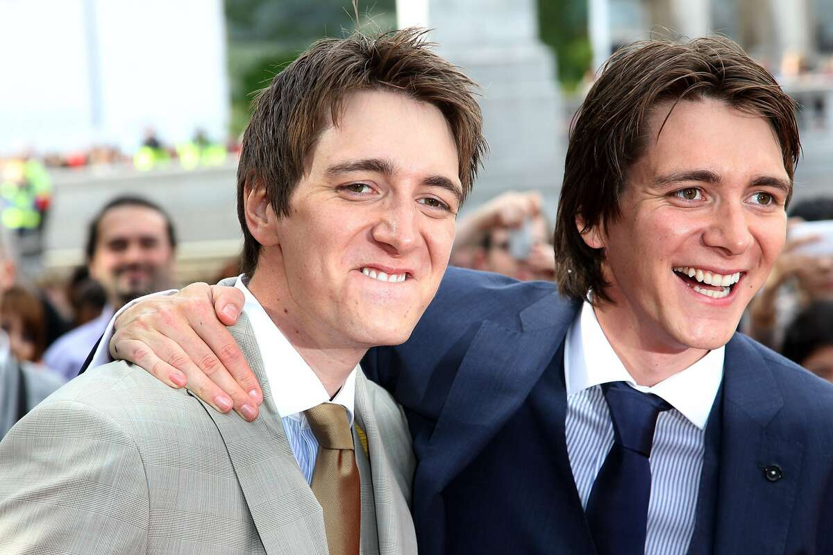 LONDON, ENGLAND - JULY 07: (UK TABLOID NEWSPAPERS OUT) James and Oliver Phelps attend the world premiere of Harry Potter and the Deathly Hallows Part 2 at Trafalgar Square on July 7, 2011 in London, England. (Photo by Dave Hogan/Getty Images)