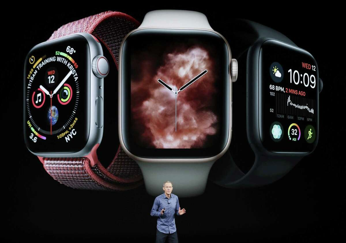 FILE - In this Sept. 12, 2018, file photo, Jeff Williams, Apple's chief operating officer, speaks about the Apple Watch Series 4 at the Steve Jobs Theater during an event to announce new Apple products in Cupertino, Calif. The latest software update to the newest Apple Watch, the Series 4, will now let people take EKGs of their heart and notify them when they have an irregular heartbeat. (AP Photo/Marcio Jose Sanchez, File)