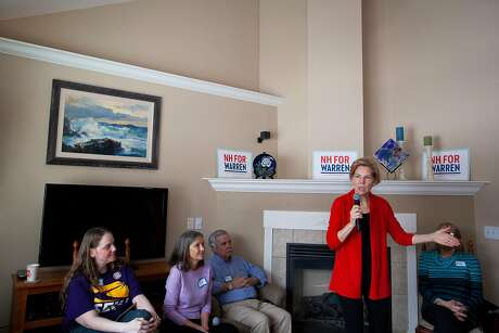 FILE - Sen. Elizabeth Warren (D-Mass.), a Democratic presidential hopeful, speaks during an event at a home in Laconia, N.H., Feb. 23, 2019. Warren is set to announce a regulatory plan aimed at breaking up some of America's largest tech companies, including Amazon, Google, and Facebook. (Elizabeth Frantz/The New York Times)