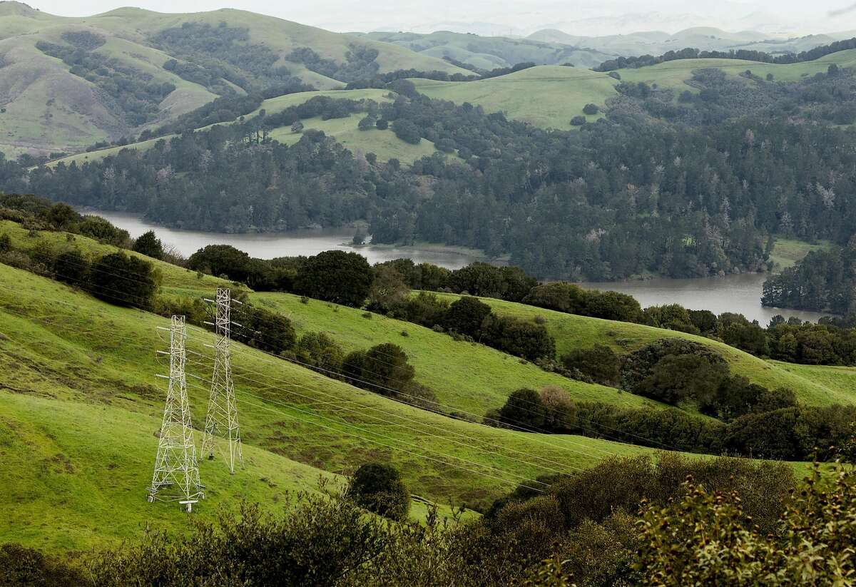 Rolling hills and power lines stretch across San Pablo Reservoir watershed seen from Wildcat Canyon Road near Inspiration Point in Orinda, Calif. Thursday, March 7, 2019.