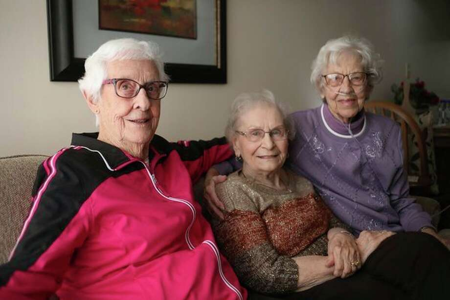 From left, Betty Jacobs, Margaret Wejrowski and Ethyl Jacobs, all 93, pose for a portrait  Jan. 31 at Washington Woods. (Katy Kildee/kkildee@mdn.net)