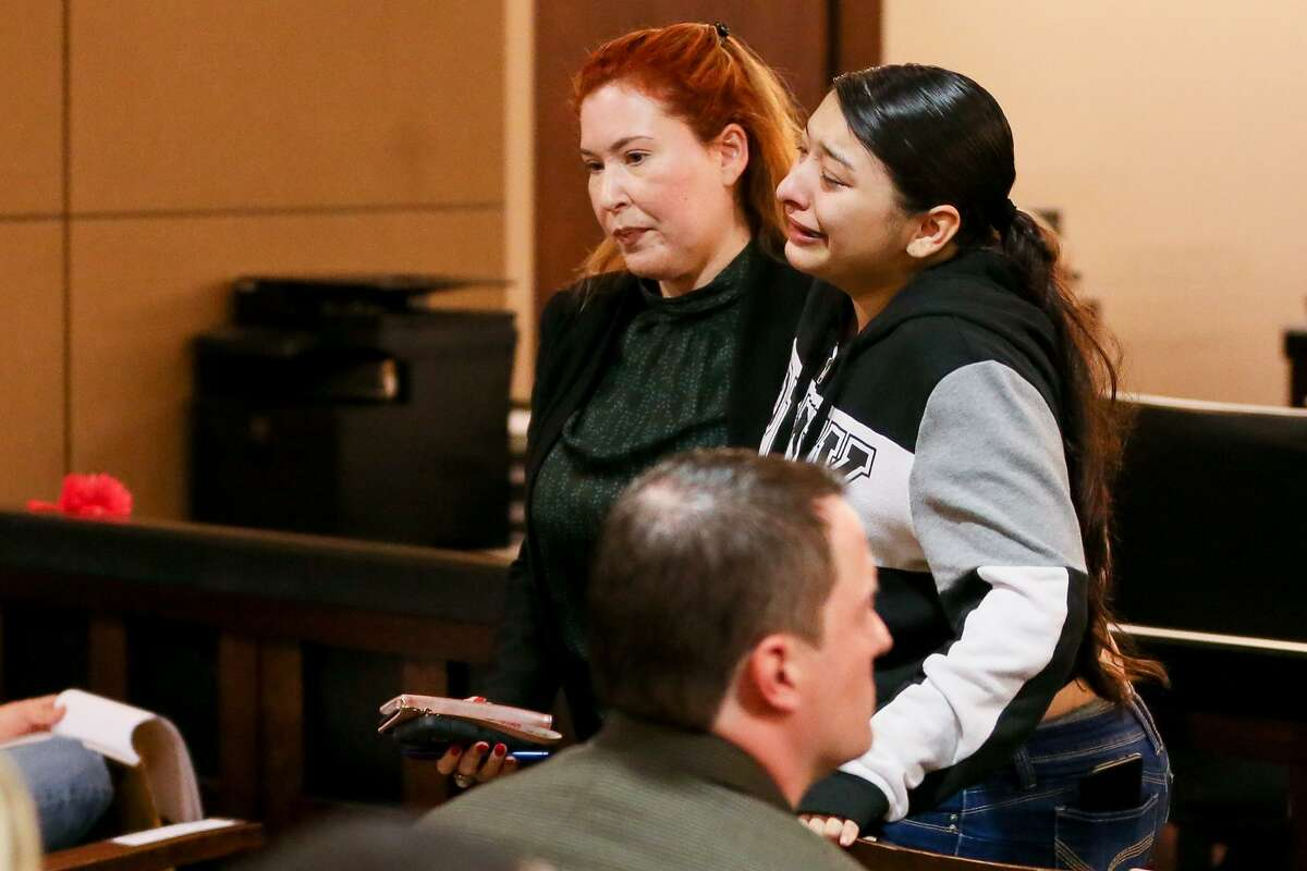 Baby Vasquez, right, overcome by emotion, is helped out of the courtroom by advocate Valerie Duncan during closing arguments Friday.