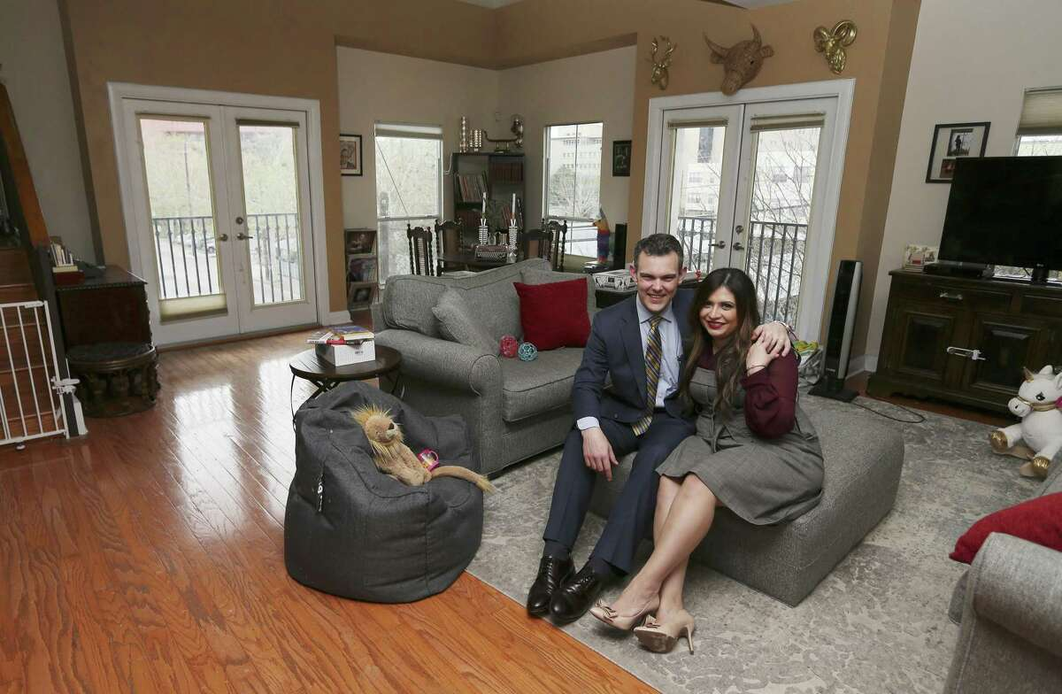 Attorney T.J. Mayes and his wife, Laura Elizabeth, rent their home in downtown San Antonio. They enjoy the amenities and conveniences that downtown living provides but are undecided if they will stay after their lease ends or opt to move to a more traditional residential community. (Kin Man Hui/San Antonio Express-News)