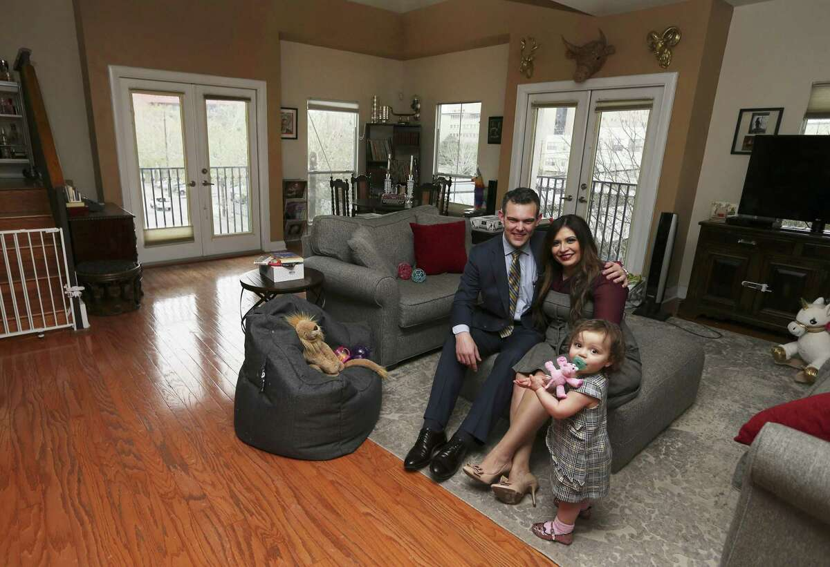 Attorney T.J. Mayes and his wife, Laura Elizabeth, and their toddler Marisa rent their home in downtown San Antonio. They enjoy the amenities and conveniences that downtown living provides but are undecided if they will stay after their lease ends or opt to move to a more traditional residential community. (Kin Man Hui/San Antonio Express-News)