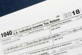 FILE - This July 24, 2018, file photo shows a portion of the 1040 U.S. Individual Income Tax Return form for 2018 in New York. If you've lost or never received your W-2, old tax returns, 1099s or 1098s to complete your tax return, there are a few things you can do to get back on track and give yourself more time.  (AP Photo/Mark Lennihan, File)