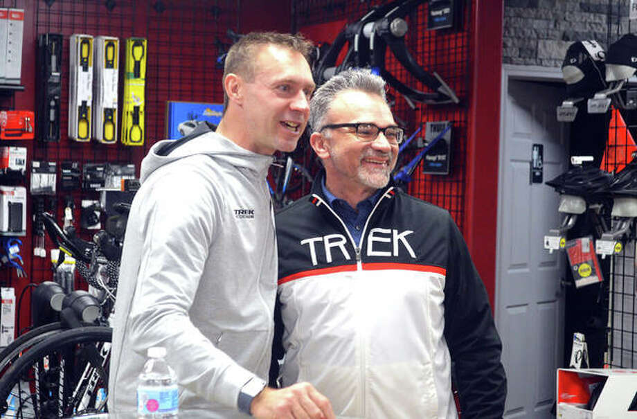 Retired German cyclist Jens Voigt, left, poses for a photo with Troy Gilmore, of Springfield during Voigt's promotional appearance on Thursday night at the Cyclery in Edwardsville. Photo: Scott Marion | Intelligencer