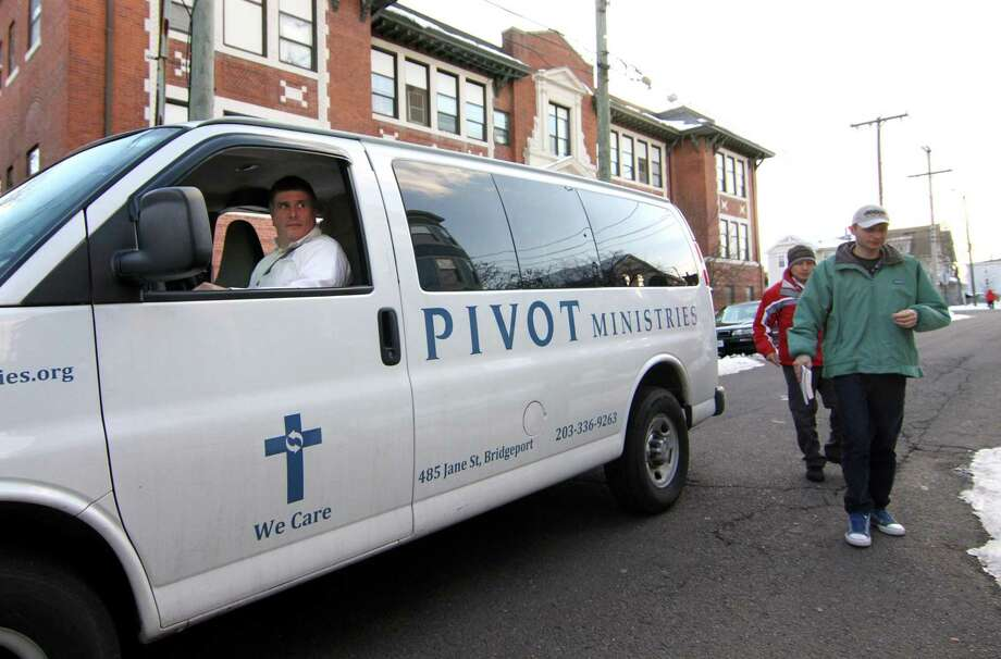 Troy Magnuson, a case manager at Pivot Ministries, drops off members from New Vision International Ministries at the ministry building on Jane Street in Bridgeport, Conn., on Thursday Mar. 7, 2019. Magnuson picked up several members to receive counseling. Over 40 men live and work at Pivot Ministries, which counsels and treats them for drug and alcohol addiction. Photo: Christian Abraham / Hearst Connecticut Media / Connecticut Post