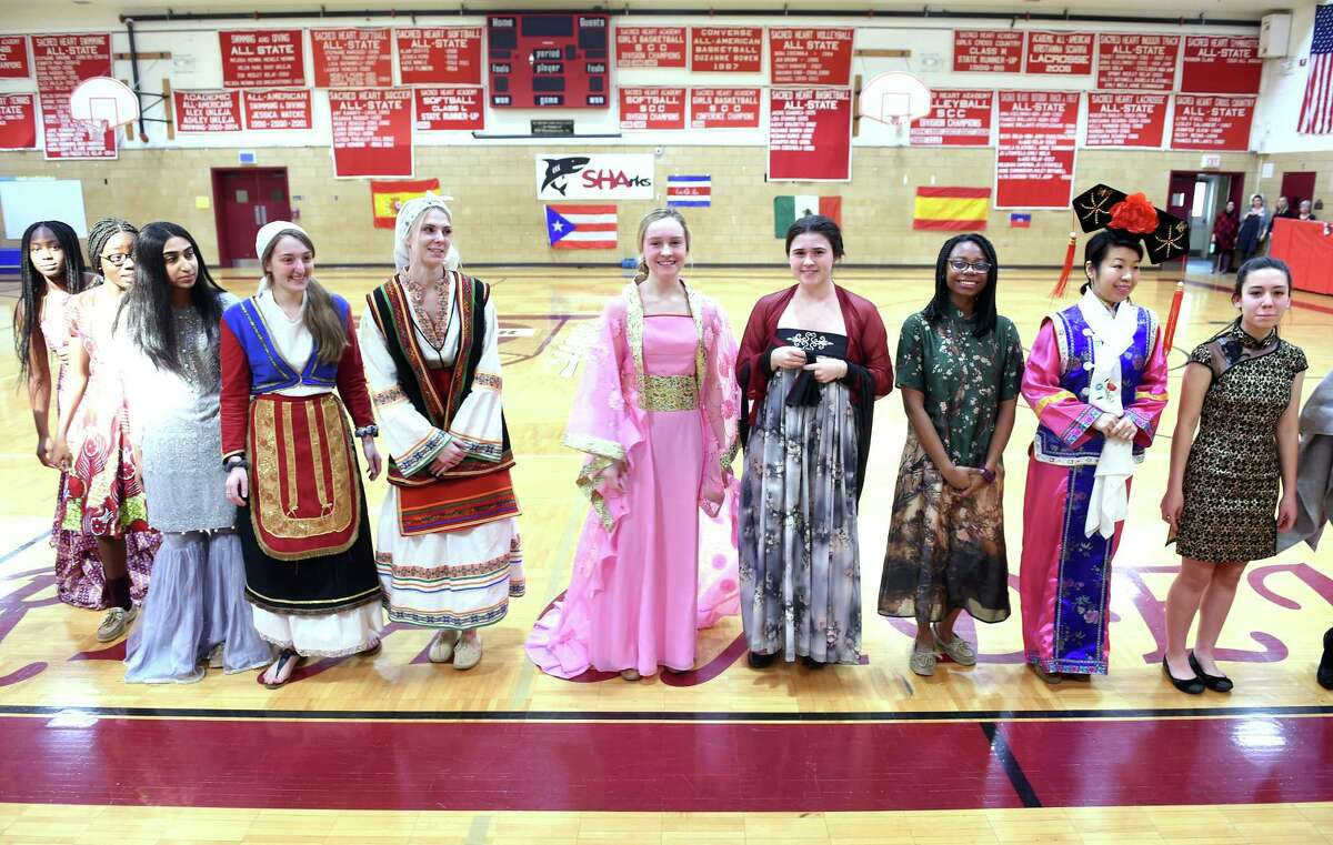 Sacred Heart Academy students wear international outfits at a fashion show during the Diversity Week Culmination Assembly at Sacred Heart Academy in Hamden organized by the student group, SHAdes of SHA, on March 8, 2019.
