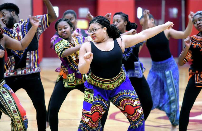 Members of the Russell Dance Company of Woodbridge perform at the Diversity Week Culmination Assembly at Sacred Heart Academy in Hamden organized by the student group, SHAdes of SHA, on March 8, 2019.