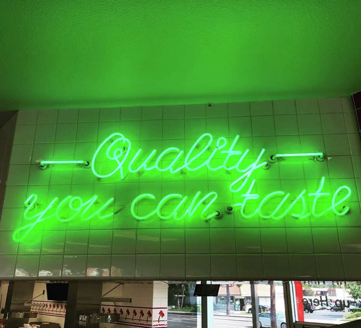 The neon sign at a handful of In-N-Out restaurants have been updated to a green glow, which the company says is a throwback to the signage from the original In-N-Out.