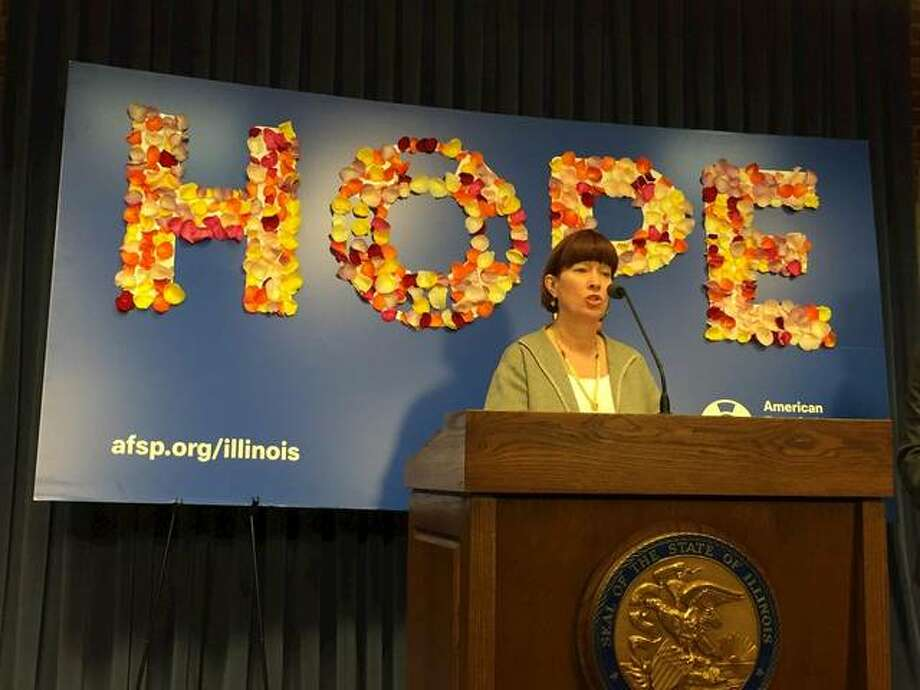 Chicago Democratic Sen. Heather Steans is sponsoring legislation that would address Illinois' suicide prevention stategy, which has not been updated since 2002. At a news event in Springfield Wednesday, March 6, she stood in front of an American Foundation for Suicide Prevention sign with flower petals on it, which represented individual suicides in 2017. Photo: Photo By Capitol News Illinois Reporter Grant Morgan