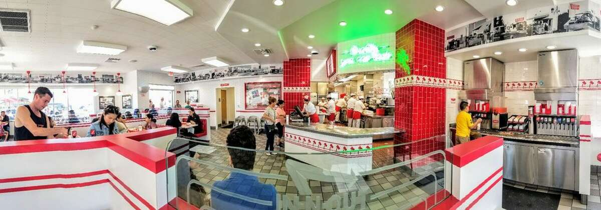 In-N-Out has been subtly making changes to its decor and has updated a handful of In-N-Out locations, including this restaurant in Santa Ana, Calif. Among the updates are the neon green sign above the register, the addition of vintage photos of the original In-N-Outs (seen toward the ceiling of the restaurant), and upgraded wallpaper and light fixtures.