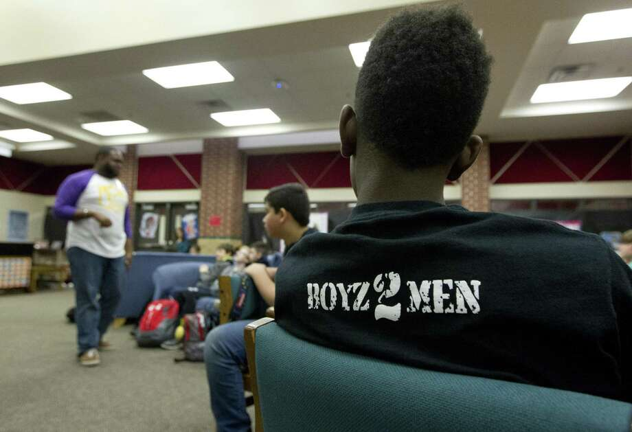 Members of Boyz 2 Men listen as Carlton Todd, assistant principal at Cryar Intermediate School, talks about being responsible at home during a meeting at Cryar Intermediate School, Friday, March 8, 2019, in Conroe. Under the guidance of mentors, the program teaches young boys leadership and life skills. Photo: Jason Fochtman, Houston Chronicle / Staff Photographer / © 2019 Houston Chronicle
