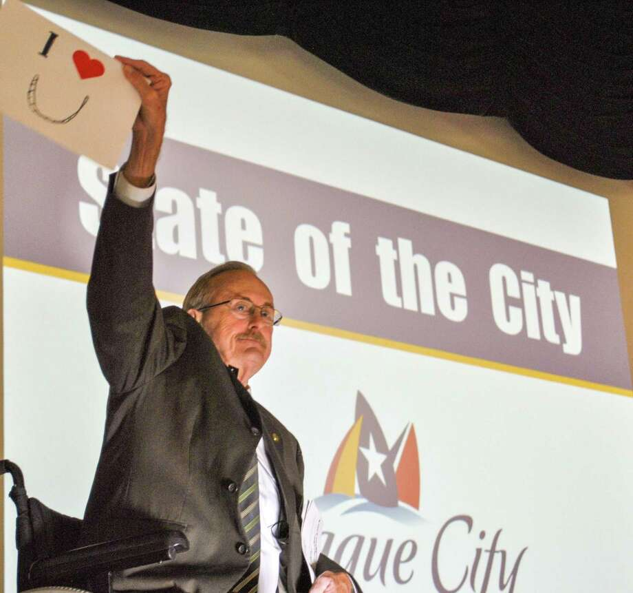 "When League City Mayor Pat Hallisey concluded his State of the City speech, he held up a sign and reminded people in attendance that the city staff ""loves you."""