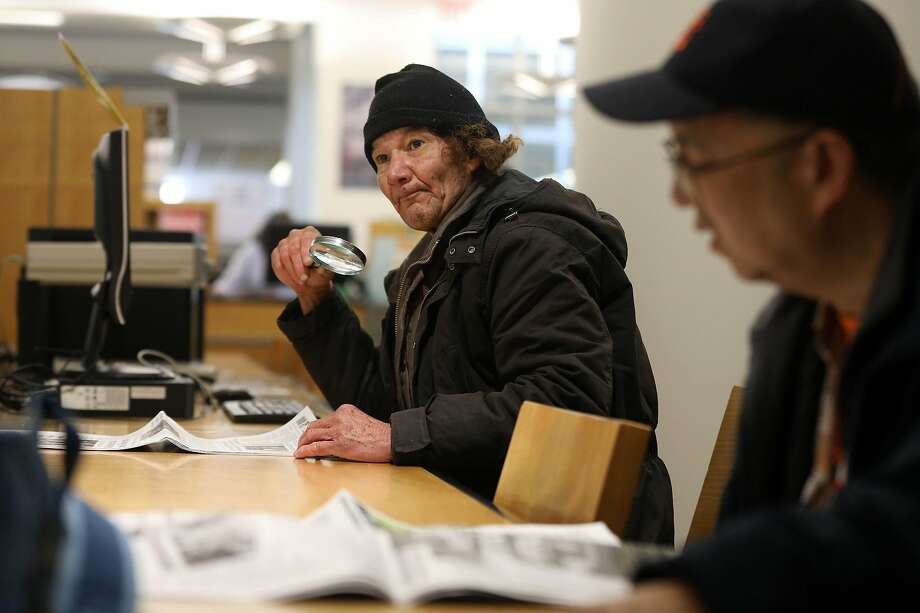 Paul Michael Landon (left), says he is homeless and visits the S.F. Main Library almost daily to study music and read. Photo: Lea Suzuki / The Chronicle