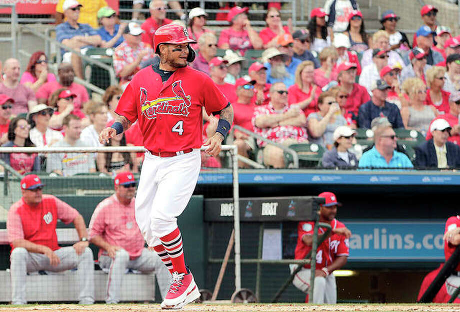The Cardinals' Yadier Molina (4) scores in the first inning during a spring training game against the Washington Nationals Friday in Jupiter, Fla. Photo: AP Photo