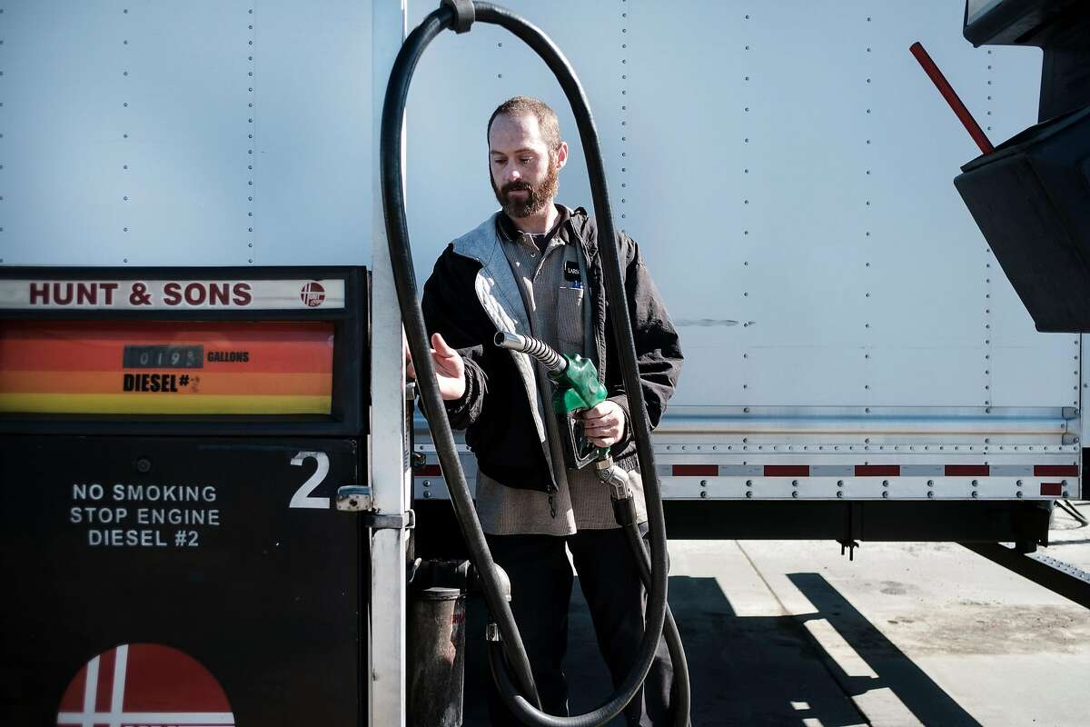 Aran Garratt, delivery driver for art framing company Carson Juhl, fills up his truck with diesel fuel at Pacific Pride Commercial Fueling in Benicia, Calif., on Friday, March 8, 2019.