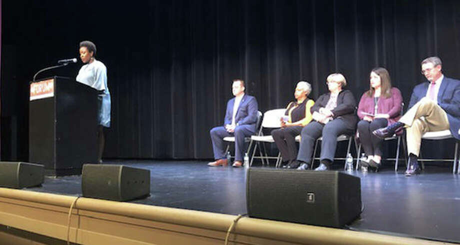 Nekisha Williams Omotola speaks to the audience during a local candidate meet and greet at the Wildey Theatre Wednesday. Omotola is a current board member and one of seven candidates running for three seats in District 7. Behind her, from left, are candidates John McDole, Debra Pitts, Jill Bertels, Katie Robberson, and Eric Levin. Not pictured is Jennifer Brumback. Photo: Charles Bolinger | The Intelligencer