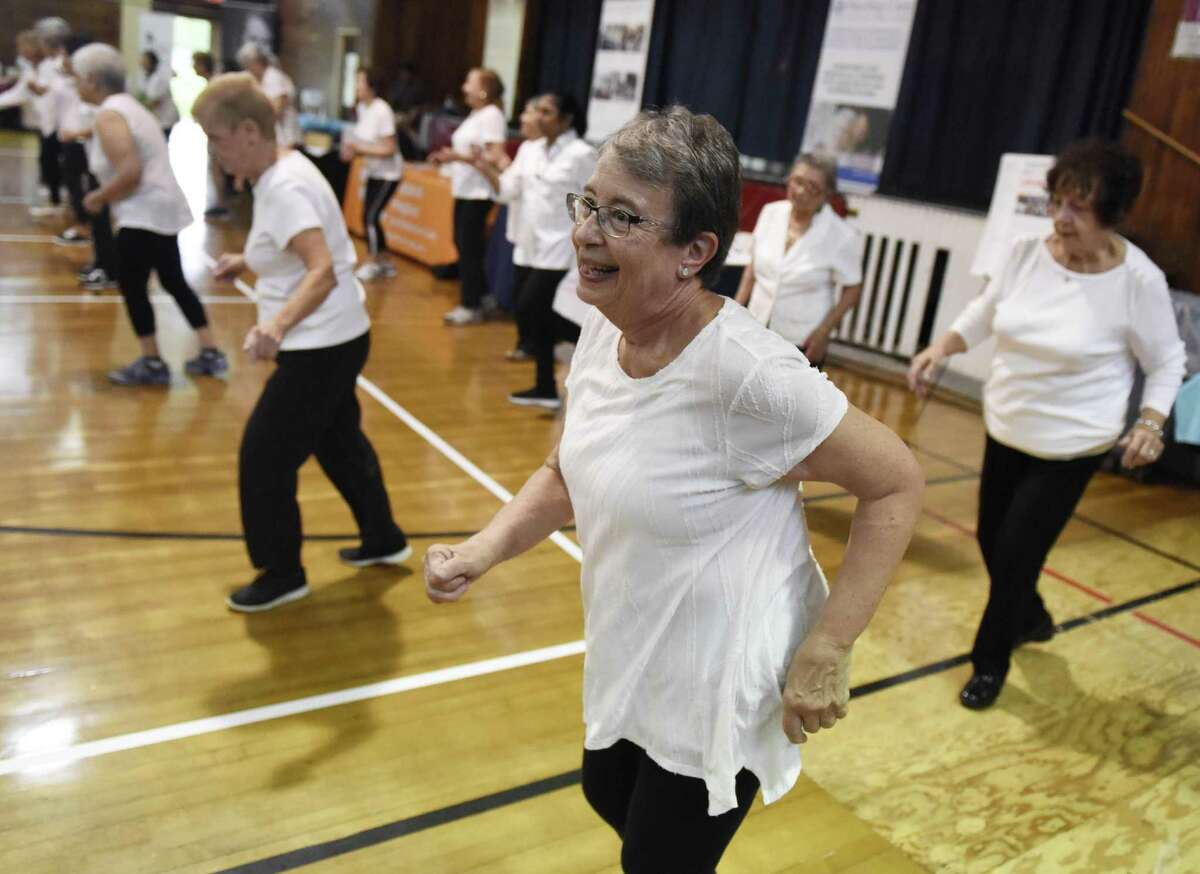 Byram resident Carole McCabe dances during a Zumba demonstration at the Health & Wellness Expo at the Eastern Greenwich Civic Center in Old Greenwich, Conn. Thursday, Oct. 11, 2018. The town is looking to build a new civic center building.