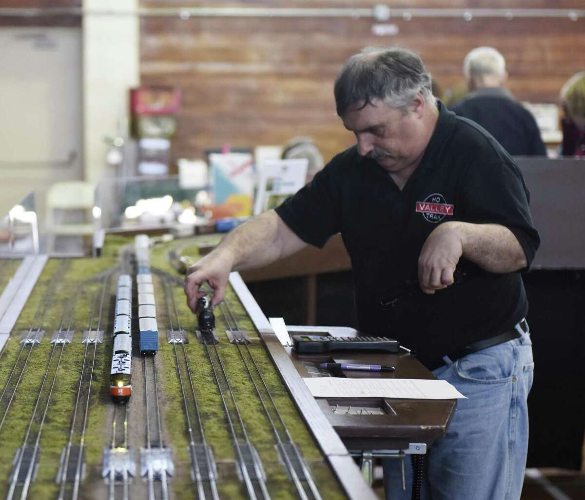Paul Hrebik, of Valley HO Track, puts a train on the tracks during the Southern CT Model Train Show at the Eastern Greenwich Civic Center in Old Greenwich, Conn. Sunday, March 11, 2018. The town is looking to build a new civic center building.