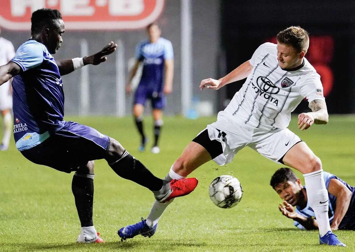 San Antonio FC midfielder Jack Barmby battles for ball during exhibition vs. El Paso Locomotive.