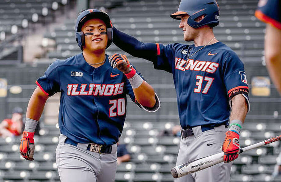 Branden Comia of Illinois (20) is congratulated by teammate Zac Taylor during a recent Illini baseball game. Illinois visits Grand Canyon this weekend in its first trip to the state of Arizona since 2001. Photo: Illini Athletics
