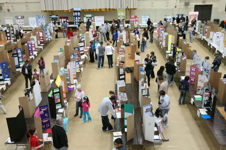 Community members walk down the aisles as students demonstrate or talk about the Science projects Saturday during the 27 Annual Permian Basin Regional Science Fair at the University of Texas of the Permian Basin. Photo: Cindeka Nealy/Midland Reporter-Telegram