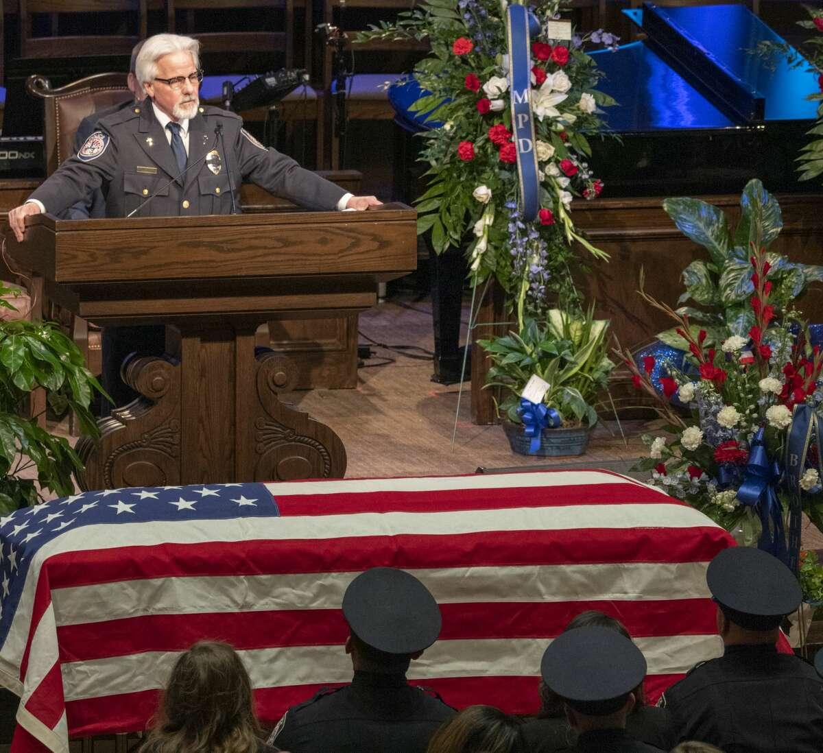 Police Chaplain Rev. Mark Dettman speaks at First Baptist Church 03/08/2019 during funeral services for Officer Nathan Heidelberg. Tim Fischer/Reporter-Telegram