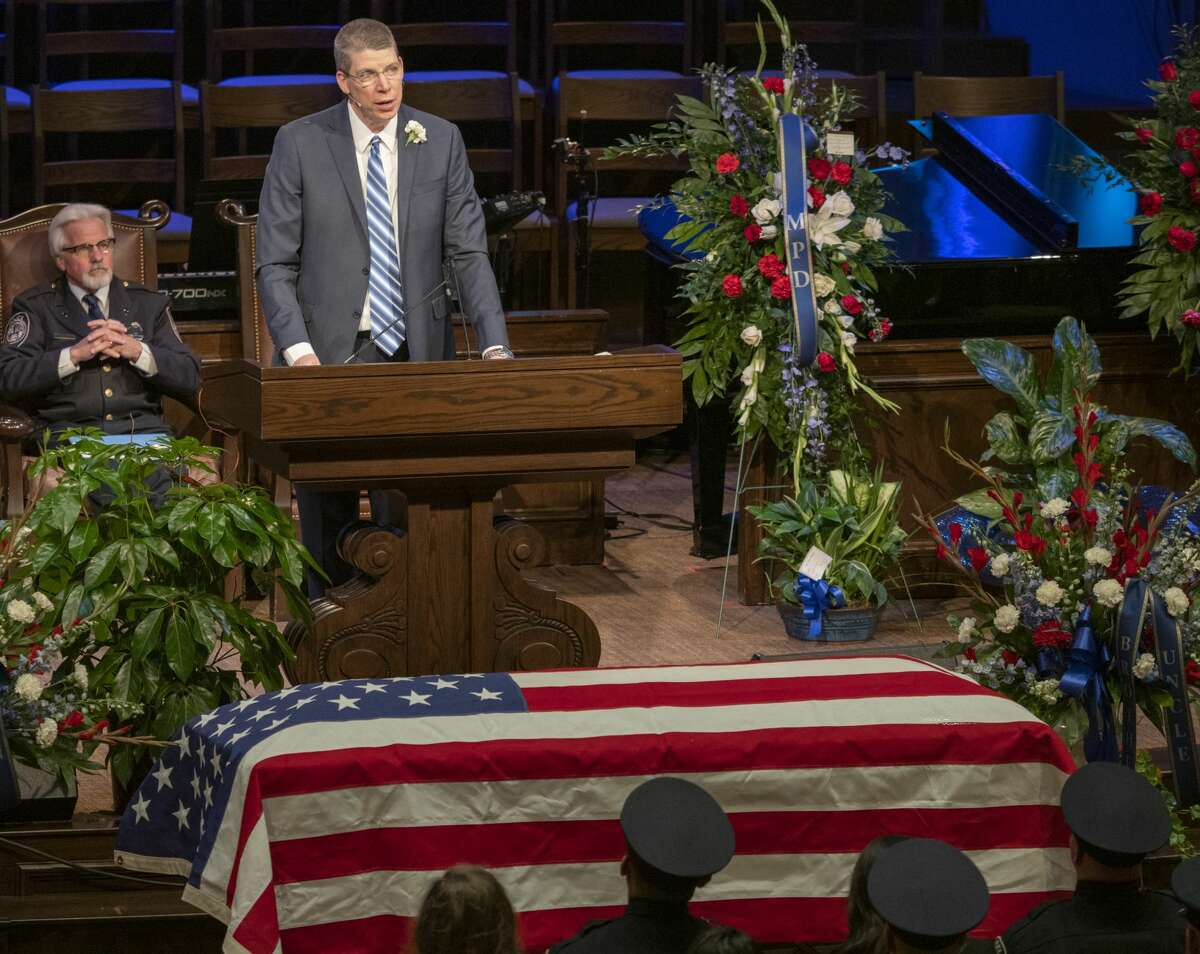 Pastor Darin Wood of First Baptist Church offers words of comfort from the Bible 03/08/2019 during funeral services for Officer Nathan Heidelberg. Tim Fischer/Reporter-Telegram