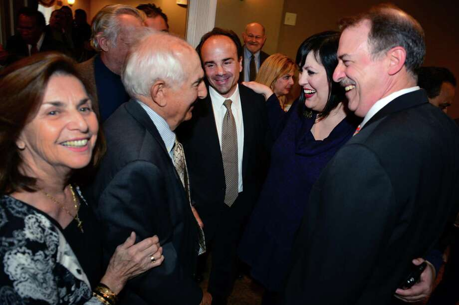 Former Bridgeport Mayor Joseph P. Ganim, center, stands with his parents Josephine, left, and George Sr.. during a fundraising event for Ganim at Vazzano's Four Seasons in Stratford, Conn., on Thursday Apr. 23, 2015. At right is Ben Walker with Maria Pereira. Photo: Christian Abraham / Christian Abraham / Connecticut Post