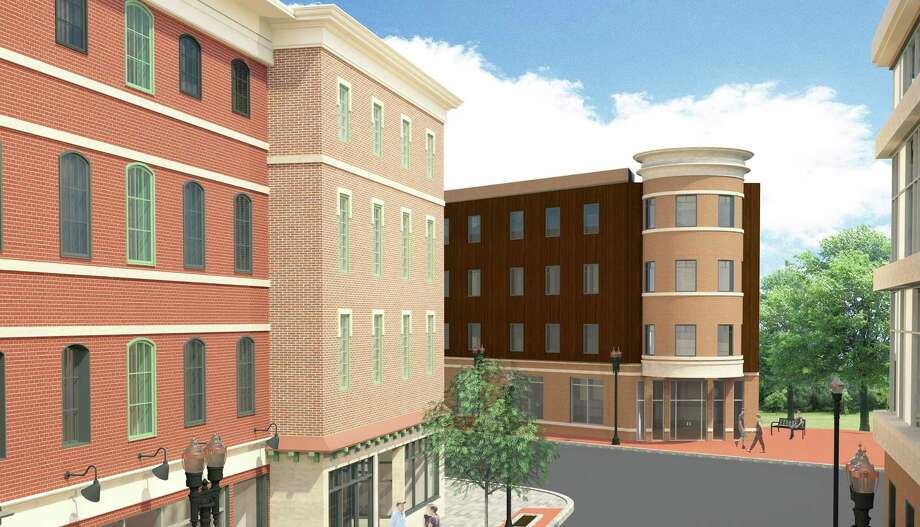 The Planning and Zoning Commission cleared the way for the development in downtown Derby by turning Factory Street into a Planned Development District which will allow Derby Downtown, LLC to propose their $400 million project next month. The plan includes four story buildings totaling 400 apartments on the upper floors and retail on the first floor. Photo: Contributed Rendering / Contributed / Connecticut Post Contributed