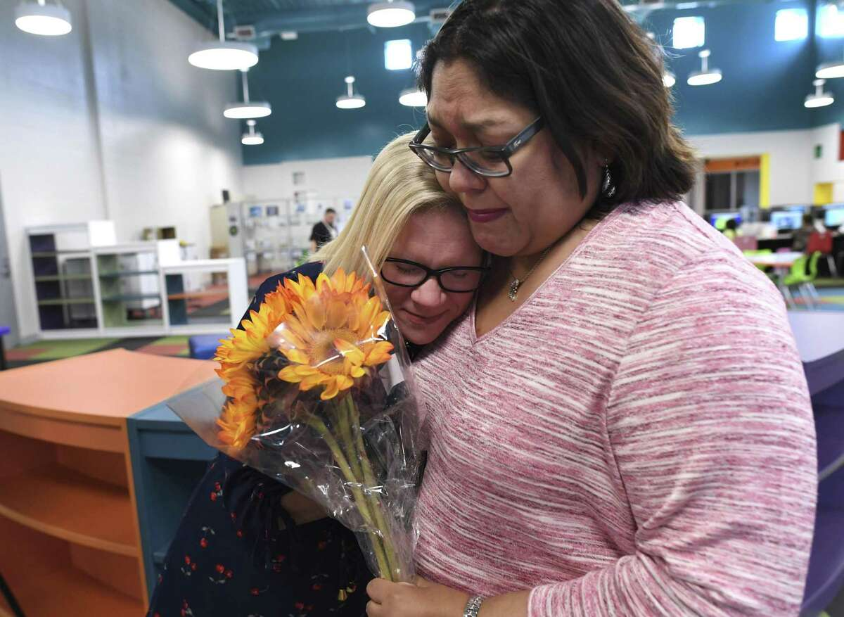 Pamela Davis, left, a kindergarten teacher at Menchaca Early Childhood Center in the Southside ISD, meets with Jennifer Trevino, her former classmate at Business Careers High School, to whom she recently donated a kidney. Trevino credits Davis with saving her life, but Davis said that, on the contrary, Trevino saved her life because she had to lose 150 pounds to donate.