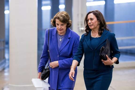 UNITED STATES - SEPTEMBER 7: Sen. Dianne Feinstein, D-Calif., left, and Sen. Kamala Harris, D-Calif., talk as they arrive in the Capitol for a vote on Thursday, Sept. 7, 2017. (Photo By Bill Clark/CQ Roll Call)