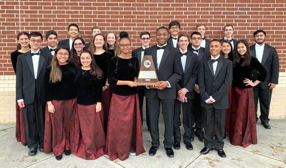 Summer Creek High School orchestra pose with their UIL trophy. Photo: Courtesy Image