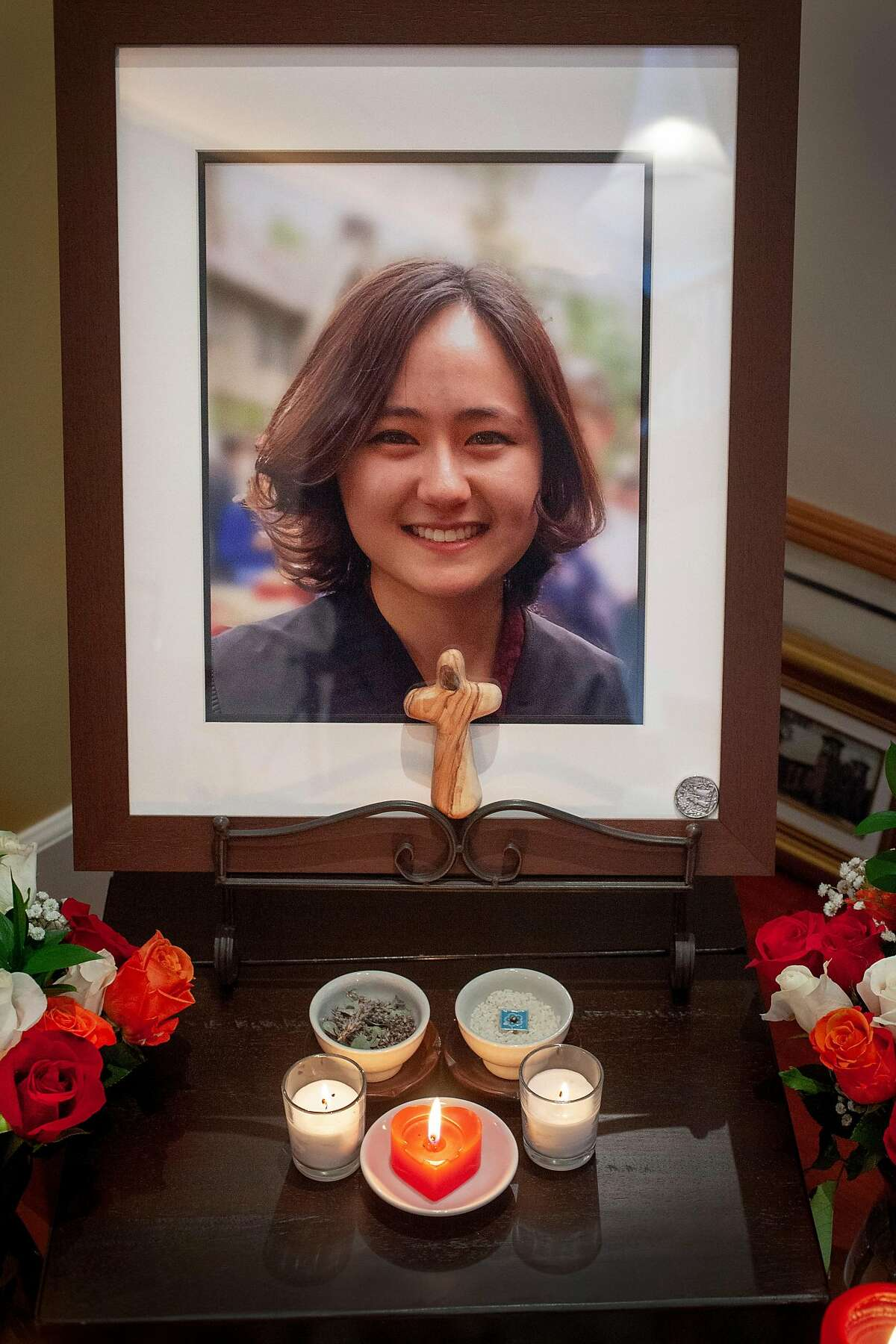 Candles burn around a photograph of Elizabeth at the alter in her home. Challenges of a healthcare crisis. Elizabeth Morgan Brown hung herself but lived with serious brain damage until she died at home.